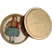 Tiny all bisque doll in a box