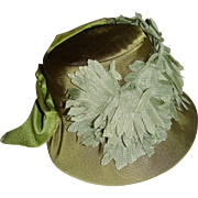 Beautiful green trimmed doll bonnet