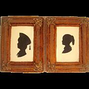 Pair 19th century silhouettes of children
