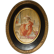 Early silk embroidered picture of lady sewing in eglomise frame