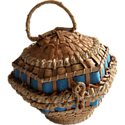 Early straw basket with ribbon trim with hats in