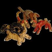 Tiny old raffia animals