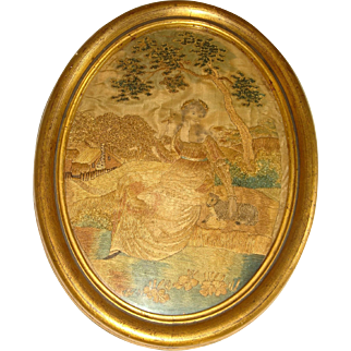 Early silk embroidered picture lady with a lamb