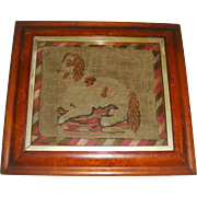 Early needlepoint  of dog in maple frame