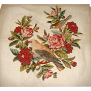 Antique needle work of birds and roses