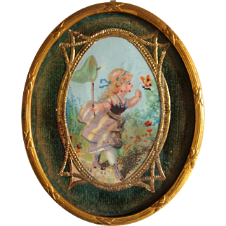 Miniature oval ormolu framed picture with Dresden paper