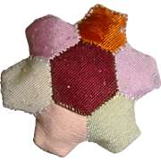 Tiny old patchwork pin cushion