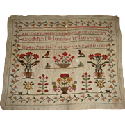 Sampler 1825 with flowers and  birds very colorful by Hariet Craven aged 11