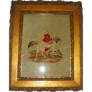 Early needlepoint picture of lady on horse back