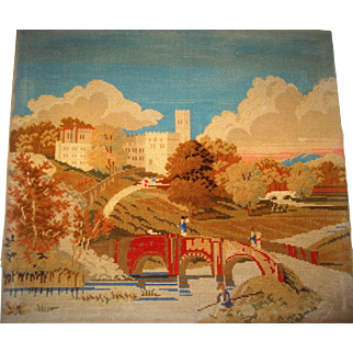 Large wool work picture of castle scene