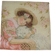 Needle point picture of girl with cat