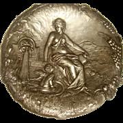 Art Nouveau pewter plaque with cherub