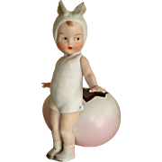 Delightful Huebach child rabbit and egg piano baby