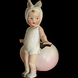 Delightful Huebach child rabbit and egg piano baby