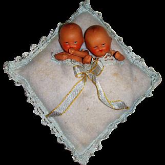 Adorable twin sprayed bisque babies