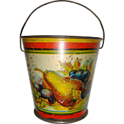 Super old tin bucket with flowers and fruit