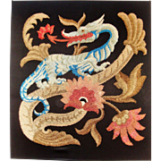 Antique embroidery of dragon and flowers