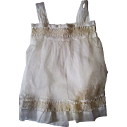 Charming lace and net pinafore for large doll