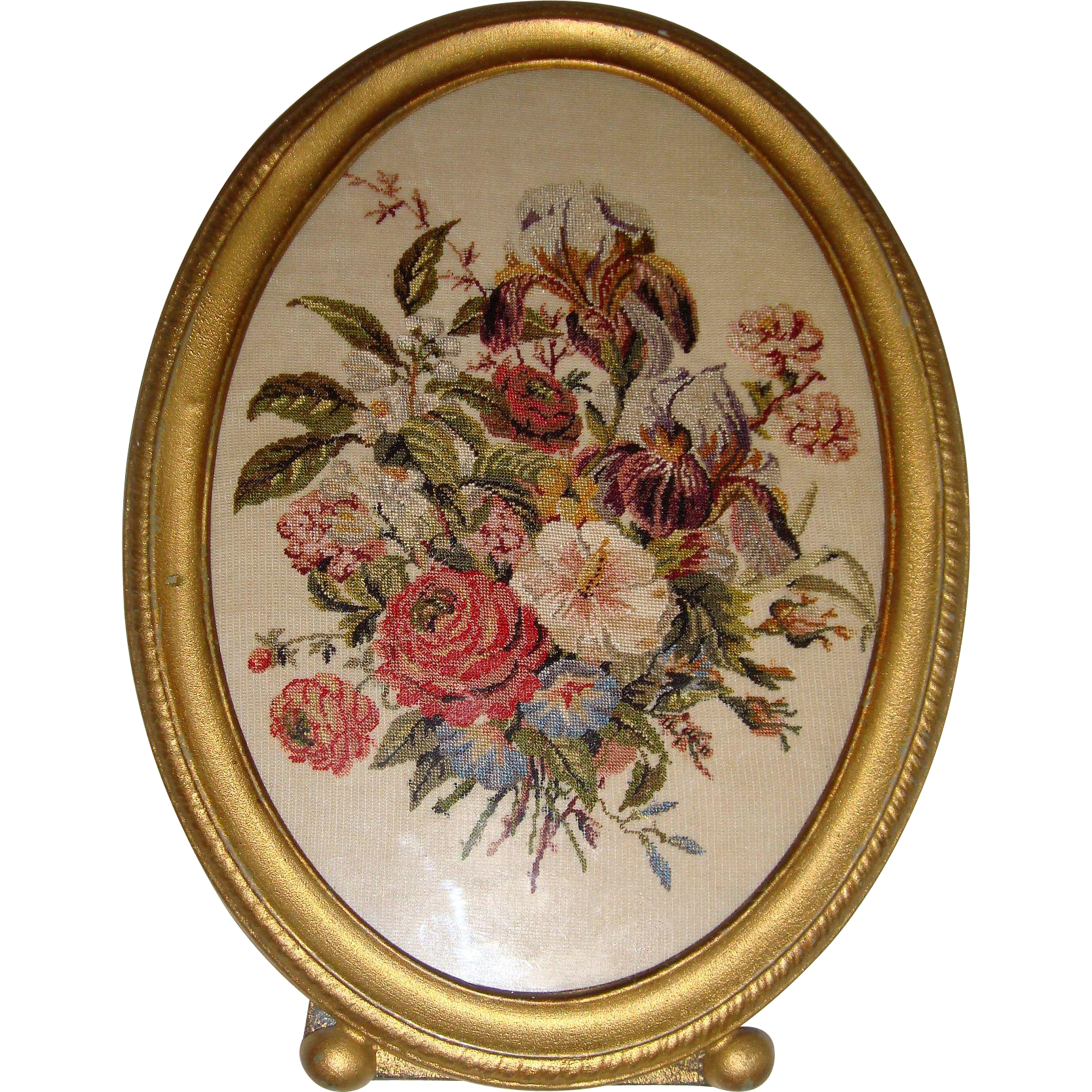 Petite point picture of flowers in oval frame