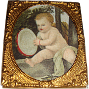 Miniature ormolu framed picture of  cherub
