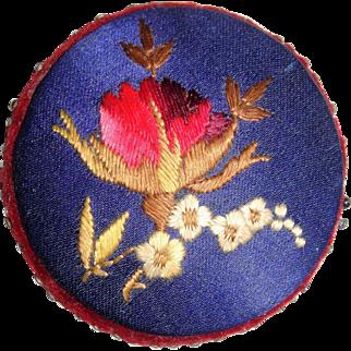Circular embroidered silk pin cushion
