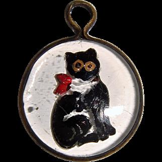 Tiny pressed glass charm of black cat