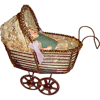Charming German wire work pram with doll