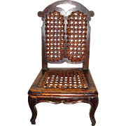 Delightful old caned chair for a doll