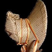 Early poke bonnet for wooden doll