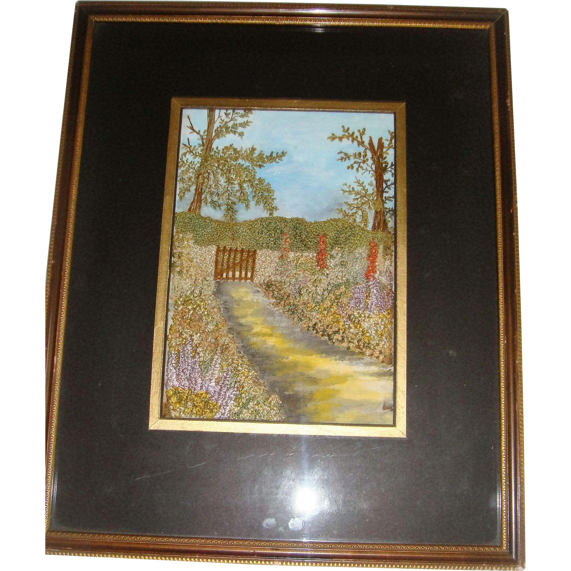 Silk embroidered picture in eglomise frame
