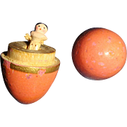 Tiny wooden doll in an egg