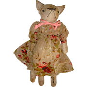 Charming old cloth cat with gorgeous dress