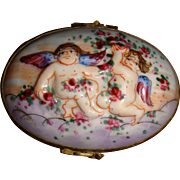 Antique Limoges box with cherubs