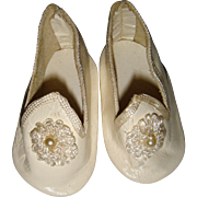 Pair pretty white shoes marked B with rosettes
