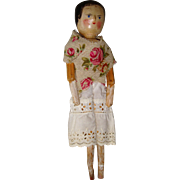 Old wooden peg doll for new home