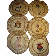 Hand painted doilies with children