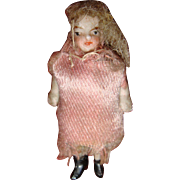 Tiny dressed Hertwig doll for dolls house