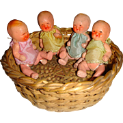 Cute little quad baby dolls in basket