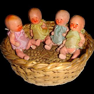 Cute little quad baby dolls in basket