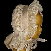 Lace bonnet for doll