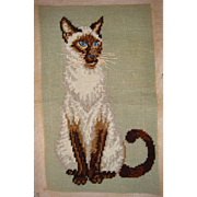 Charming needle work of Siamese cat