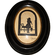 Miniature silhouette picture of Alice in Wonderland signed