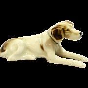 Vintage porcelain reclining hound dog figurine