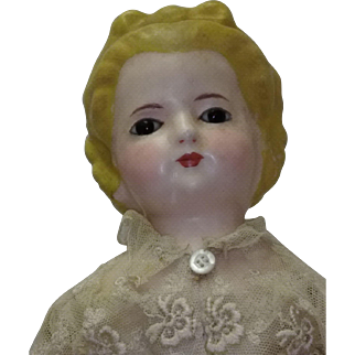 21 inch 19th Century wax over paper mache doll