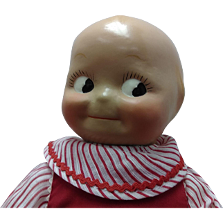 """11"""" Composition head Kewpie type with cloth body and compo hands"""