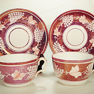 Pair of English Porcelain Pink Resist Lustre Cups and Saucers C1815-1825