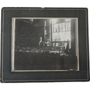Early Country store salesman at tobacco show case-early 1900's