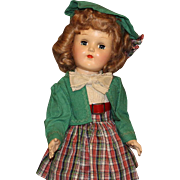 Ideal Hard Plastic Doll In Green & Plaid