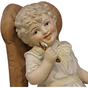 Child In A Chair - Vintage Figurine