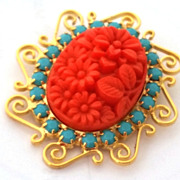 Vintage Designer Austrian Turquoise Rhinestones and Coral red carved look floral oval pendant